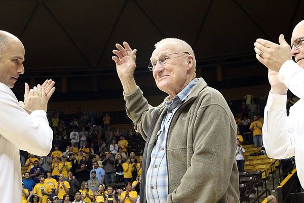 FILE - In this March 14, 2012, file photo, former Wyoming basketball star Kenny Sailors waves to the crowd during a ceremony in Laramie, Wyo., honoring his election into the National Collegiate Basketball Hall of Fame. Sailors, a College basketball Hall of Famer and the man credited by some with being the first to use the modern jump shot, died in his sleep early Saturday, Jan. 30, 2016, at an assisted living center in Laramie, Wyo., the University of Wyoming announced. He was 95. (Michael Smith/The Wyoming Tribune Eagle via AP) MANDATORY CREDIT