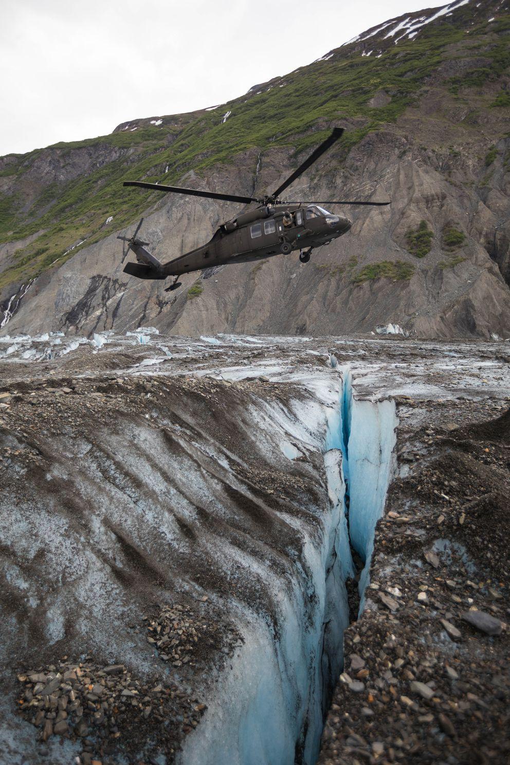 An Alaska Army National Guard UH-60 Black Hawk approaches Colony Glacier on Saturday. (Loren Holmes / ADN)
