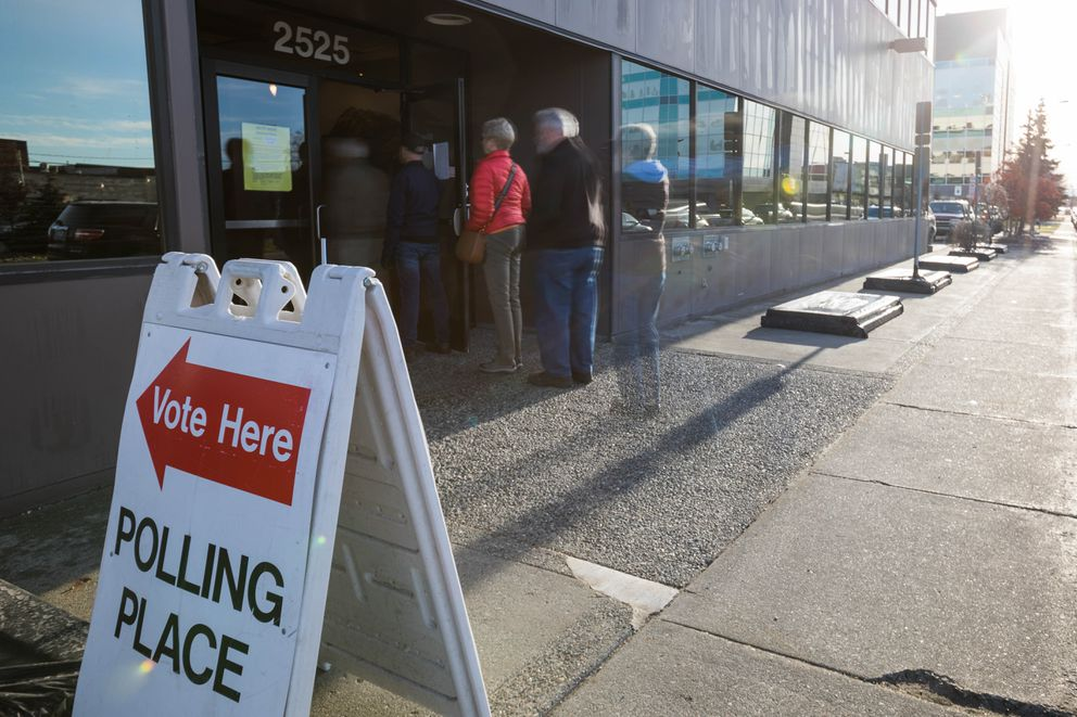 People file into the Midtown Anchorage office of the state elections division for early voting on Thursday. (Loren Holmes / Alaska Dispatch News)