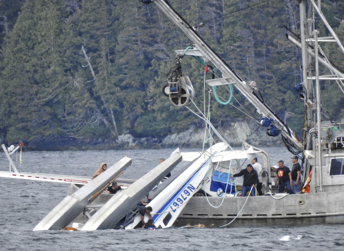 This Monday, May 20, 2019 photo provided by Aerial Leask shows good Samaritans off of fishing vessels attempting to bring in a floatplane that crashed in the harbor of Metlakatla. (Aerial Leask via AP)