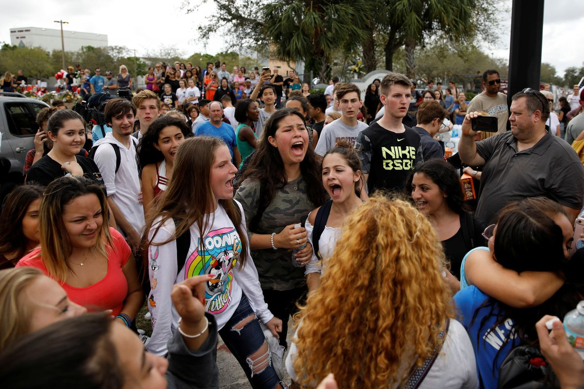Students shout slogans during a protest to show support for Marjory Stoneman Douglas High School, following a mass shooting in Parkland, Florida, U.S., Feb. 20, 2018. REUTERS/Carlos Garcia Rawlins