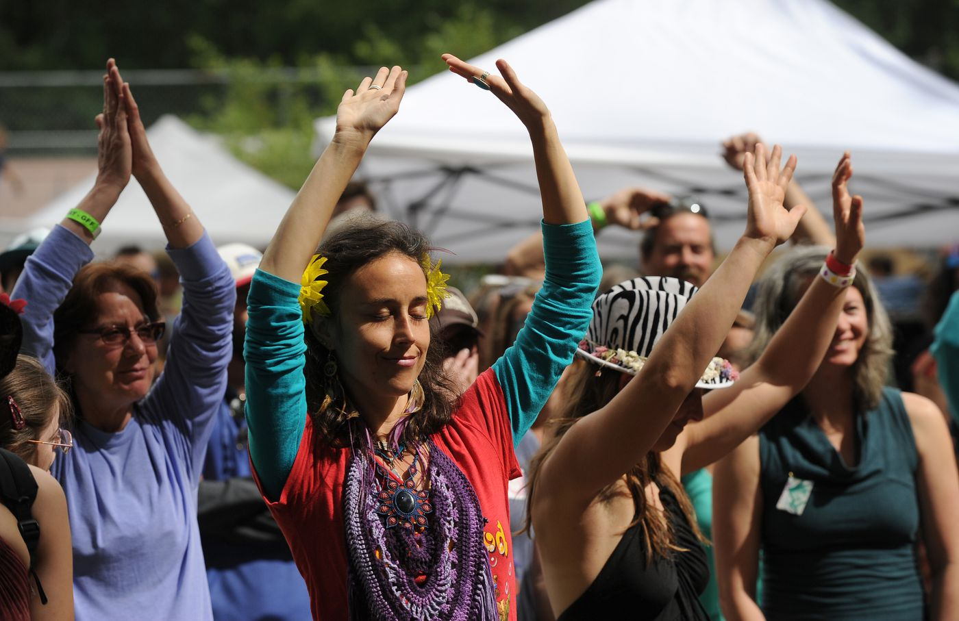 Joleen Decker and others groove to the music of the Hope Social Club at the Girdwood Forest Fair on Saturday, July 2, 2016, in Girdwood. (Bob Hallinen / Alaska Dispatch News)