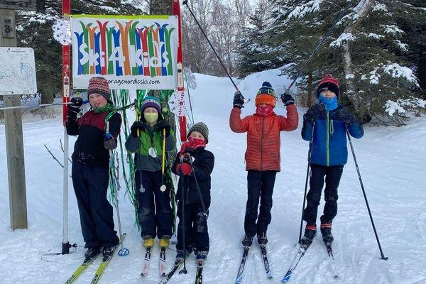 From left, Reinzi Witmer, Suvan Schwoerer, Kai Schwoerer, Ethan Elliott, and Riley Elliott gather for the week-long Ski 4 Kids at Kincaid Park. The event lasts through Sunday at Kincaid Park. (Photo by Beth Elliott)