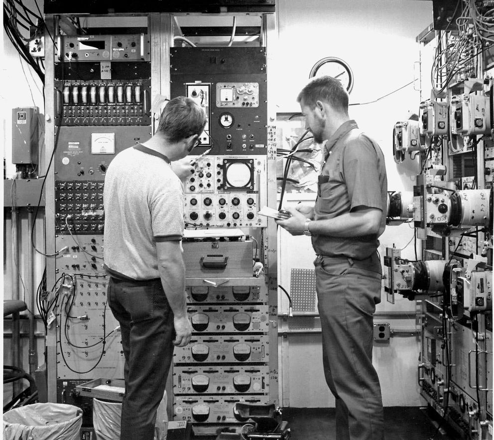 Wayne Violette and Darrel Oliver make the final checks on the instrumentation equipment before the Milrow atomic test on Amchitka. The Milrow test was a 1-megaton precursor to the 5-megaton Cannikin test, which was the largest underground test the U.S. conducted, with almost 400 times the power of the Hiroshima bomb. (DOE Flickr)