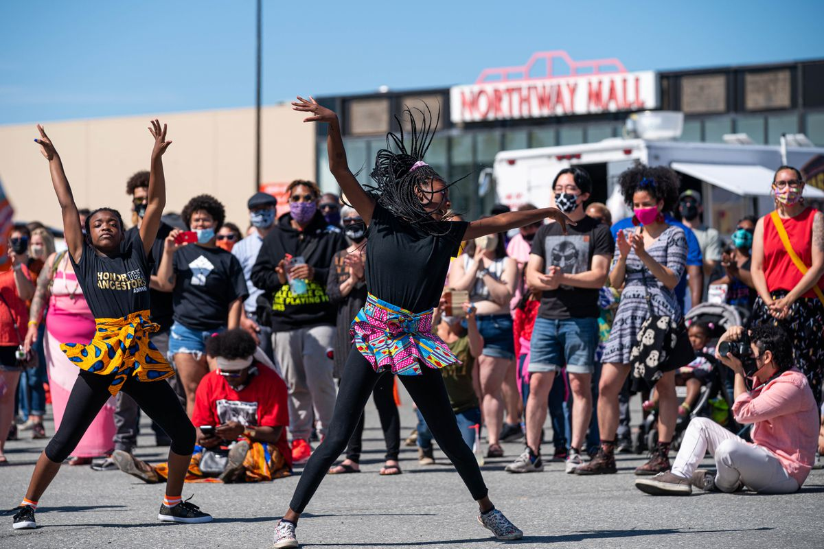 Nariah Morgan, 9, and Janya Evans, 14, perform a dance with Sankofa Dance Theater at a Juneteenth celebration on Saturday, June 13, 2020 at the Northway Mall in Anchorage. Juneteenth celebrates the ending of slavery in the United States. (Loren Holmes / ADN)