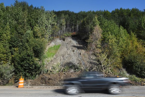Motorists pass the landslide at Mile 105 of the Seward Highway on Sunday. Debris from the landslide blocked the northbound lane on Saturday evening, causing traffic delays. (Bill Roth / ADN)