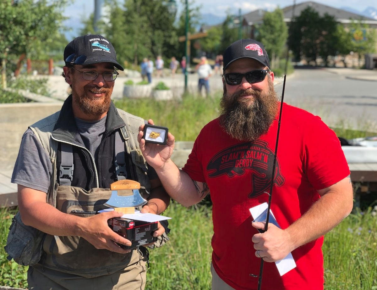 Dustin Slinker of The Bait Shack presents Robert George III with his prize package for winning the 2019 Slam'n Salm'n Derby. (Courtesy the Bait Shack)