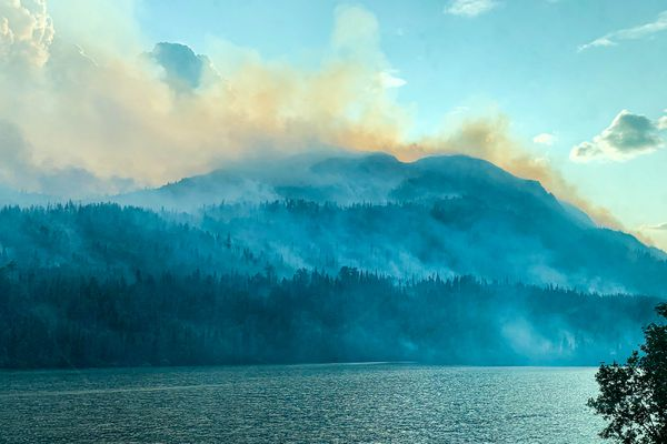 Smoke from the Swan Lake Fire rises over the Kenai Peninsula near Cooper Landing, Alaska on Friday, Aug. 23, 2019. (Matt Tunseth / ADN)