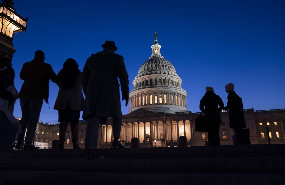"Night falls on the Capitol, in Washington, Wednesday evening, Jan. 22, 2020, during in the impeachment trial of President Donald Trump. House prosecutors are outlining what they refer to as President Donald Trump's ""corrupt scheme"" to abuse power and obstruct Congress as they open six days of arguments in his impeachment trial. (AP Photo/J. Scott Applewhite)"