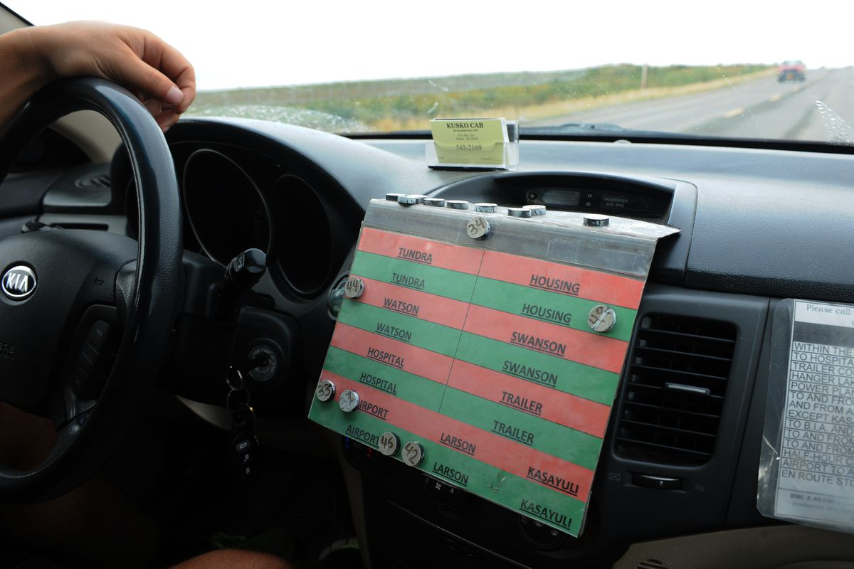 A mobile Kusko Cab dispatcher keeps track of his fleet on a board listing sections of town on a slow Aug. 28, 2014, in Bethel. (Erik Hill / ADN archive)
