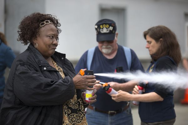 Lucille Gay practices with inert bear spray during a bear behavior and safety class, presented by the Anchorage Bear Committee, on Monday, July 17, 2017, in Anchorage.
