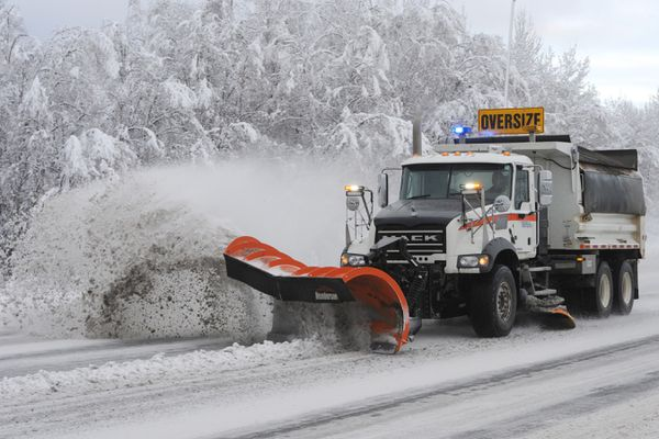 A state snowplow clears snow on the Tudor / Muldoon curve on Sunday, Nov. 17, 2019. (Bill Roth / ADN)
