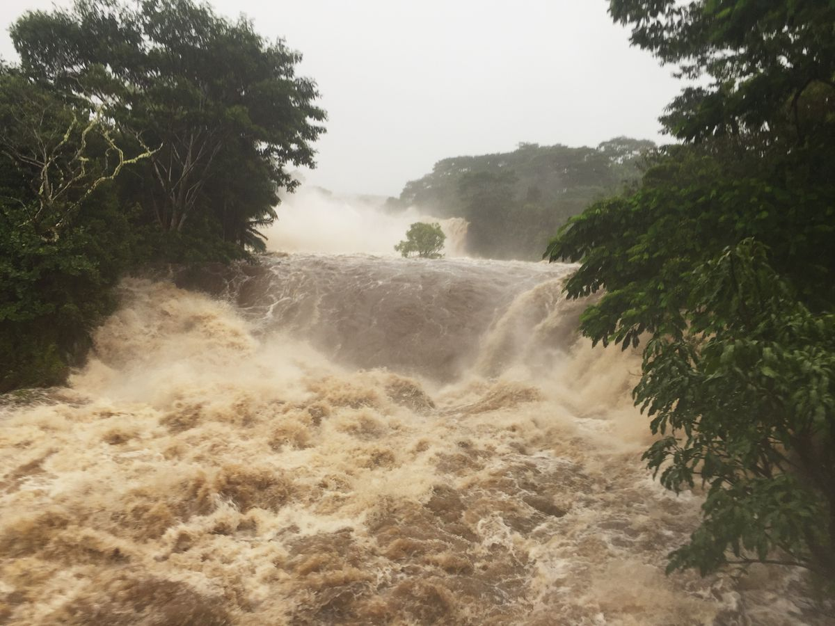 This photo provided by Jessica Henricks shows flooding Thursday, Aug. 23, 2018, Wailuku River near Hilo, Hawaii. Hurricane Lane brought torrential rains to Hawaii's Big Island and Maui before the storm was expected to hit Oahu. A powerful hurricane unleashed torrents of rain and landslides Thursday that blocked roads on the rural Big Island but didn't scare tourists away from surfing and swimming at popular Honolulu beaches still preparing get pummeled by the erratic storm. (Jessica Henricks via AP)