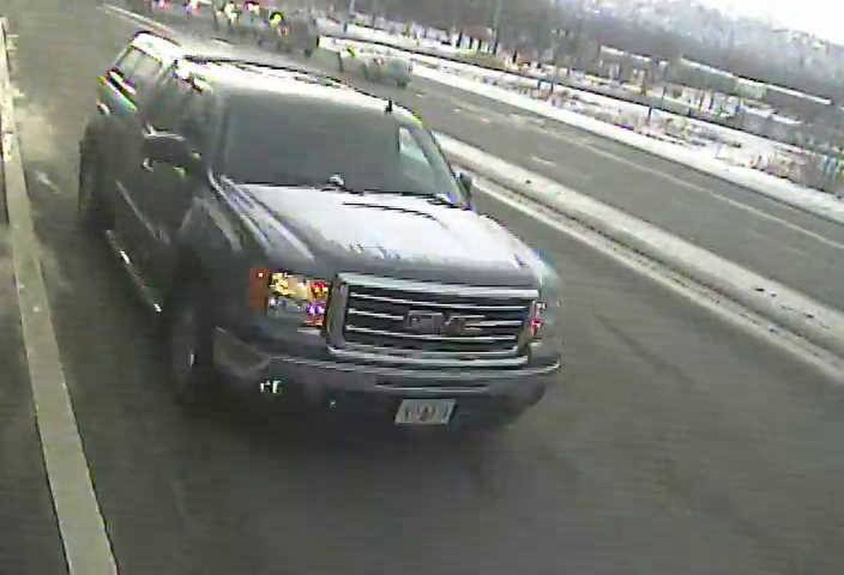 Police were searching for a green or gray GMC truck that hit a woman who was crossing Muldoon Road at the intersection with DeBarr Road on Tuesday, April 23, 2019. (Photos courtesy Anchorage Police Department.)