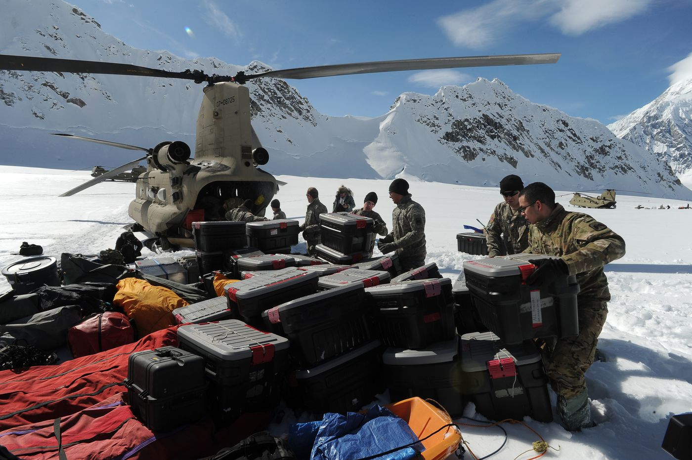 Fort Wainwright soldiers unload supplies from one of two Chinook helicopters landing at the National Park Service Denali mountaineering camp on the Kahiltna Glacier on Sunday.