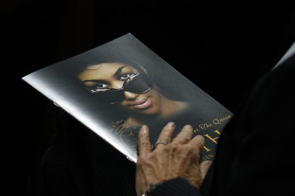 A person holds a program during the funeral service for Aretha Franklin at Greater Grace Temple, Friday, Aug. 31, 2018, in Detroit. Franklin died Aug. 16, 2018 of pancreatic cancer at the age of 76. (AP Photo/Paul Sancya)