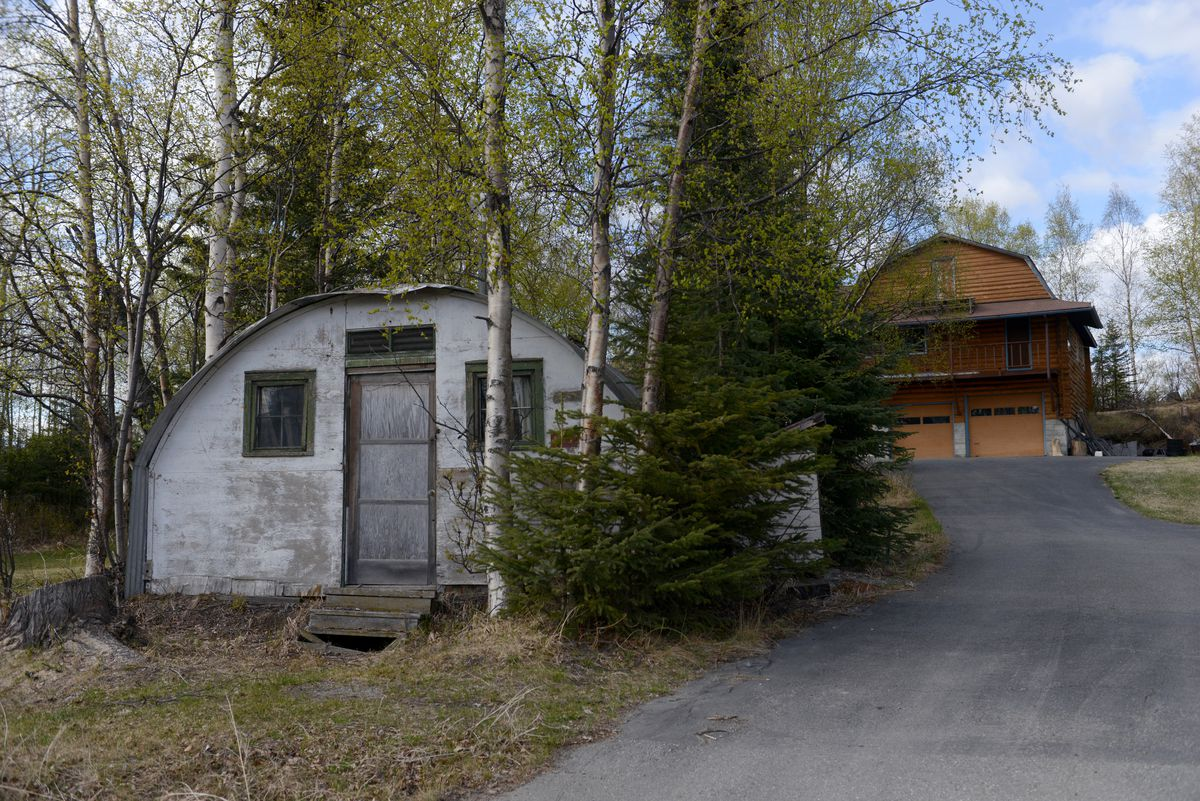 Paul Sines shows his Quonset Hut off De Armoun Road in south Anchorage, AK on Thursday, May 7, 2015. Sines moved the former Fort Richardson Quonset Hut to the property in 1960 after his prove up cabin burned. Sines lived in the Quonset Hut for about 8 years and then turned it into a shop. The hut has the original military numbers on the front and back.