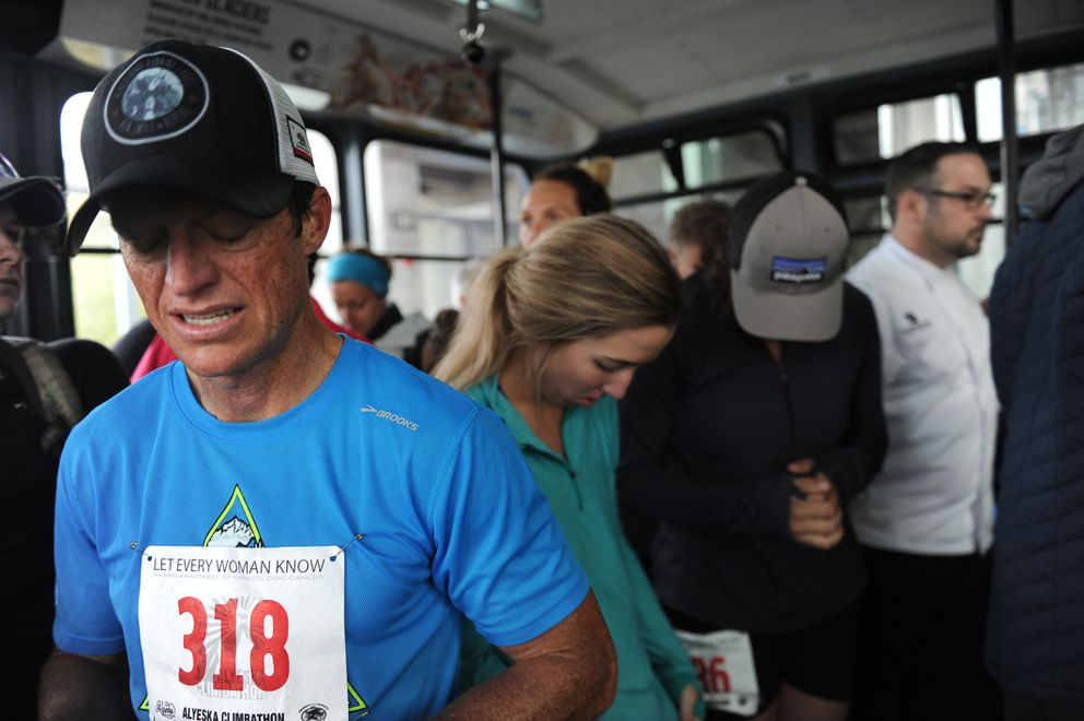 Aaron Christie and other runners ride the tram down after running up the North Face Trail. (Bob Hallinen / Alaska Dispatch News)