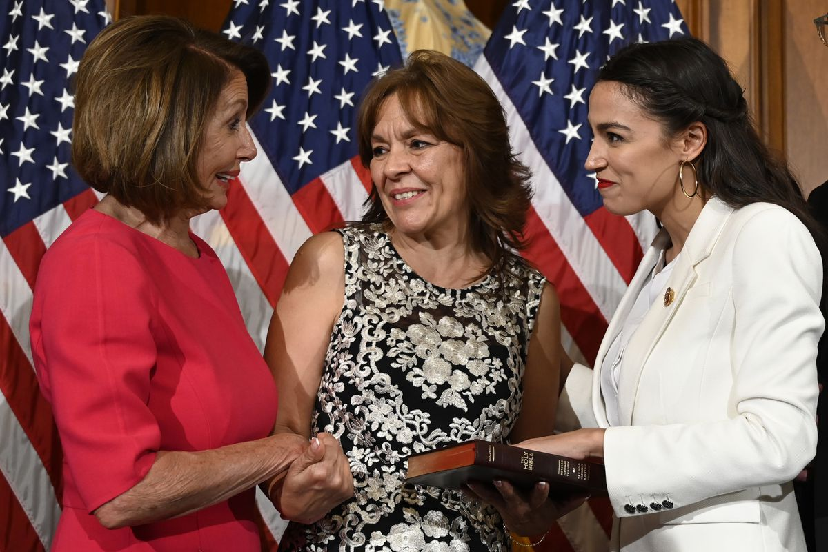 House Speaker Nancy Pelosi of Calif., left, talks with Rep. Alexandria Ocasio-Cortez, D-N.Y., right, and her mother Blanca Ocasio-Cortez, center, during a ceremonial swearing-in on Capitol Hill in Washington, Thursday, Jan. 3, 2019, during the opening session of the 116th Congress. (AP Photo/Susan Walsh)