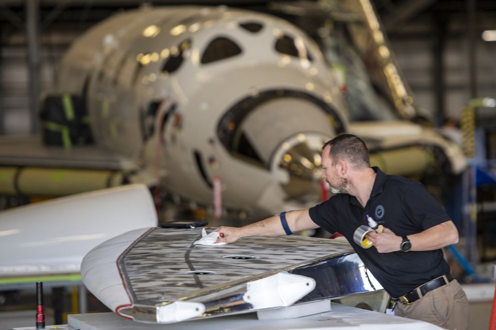 Virgin Galactic avionics technician Chris Taylor works on a horizontal stabilizer at the Virgin Galactic headquarters on Oct. 9, 2018 in Mojave, Calif. MUST CREDIT: Wahsington Post photo by Jonathan Newton