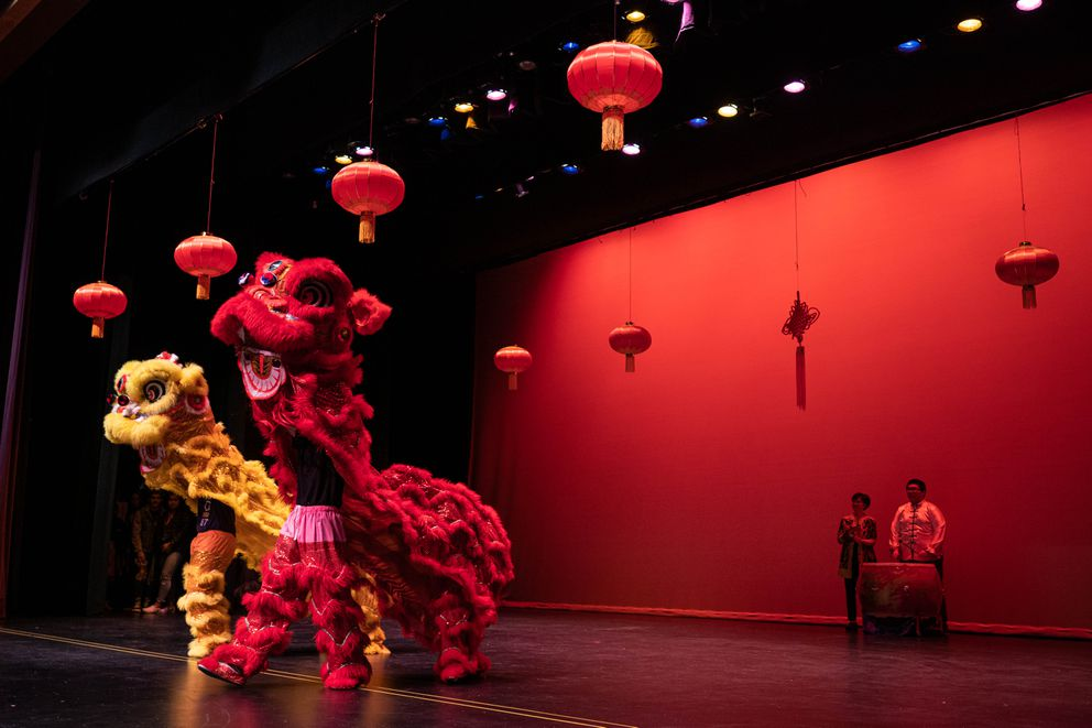 Bartlett Chinese language students perform a lion dance. (Loren Holmes / ADN)