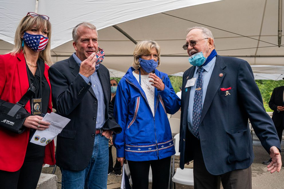 From left, Alaska Department of Public Safety commissioner Amanda Price, Sen. Dan Sullivan, R-Alaska, Sen. Lisa Murkowski, R-Alaska, and Rep. Don Young, R-Alaska, gather after an event celebrating the opening of the Anchorage Indian Affairs Cold Case Office. (Loren Holmes / ADN)