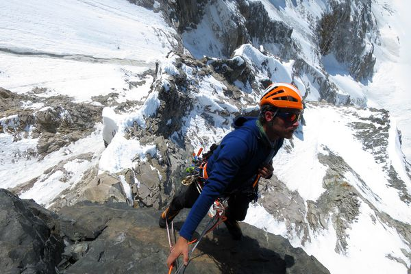 Graham Zimmerman arrives at the belay after jumaring up the loose crux pitch on the West Face Direct on Celeno Peak, in the St. Elias Mountains. (Chris Wright)