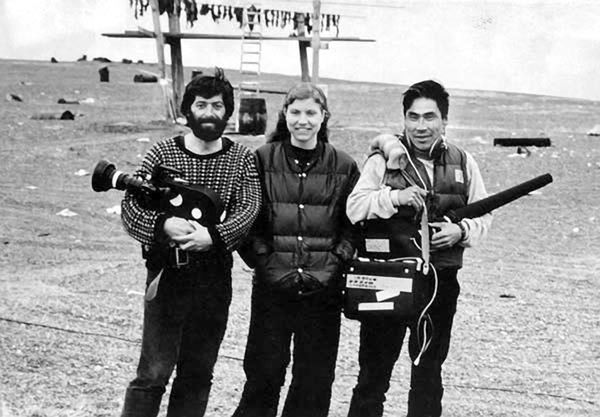 Leonard Kamerling, left, Sarah Elder and Woodrow Malewotkuk, a sound recordist, film in Gambell in April 1975. (Courtesy Sarah Elder and Leonard Kamerling)