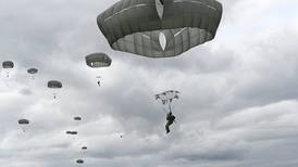 Photos: JBER paratroopers jump from Chinook helicopters