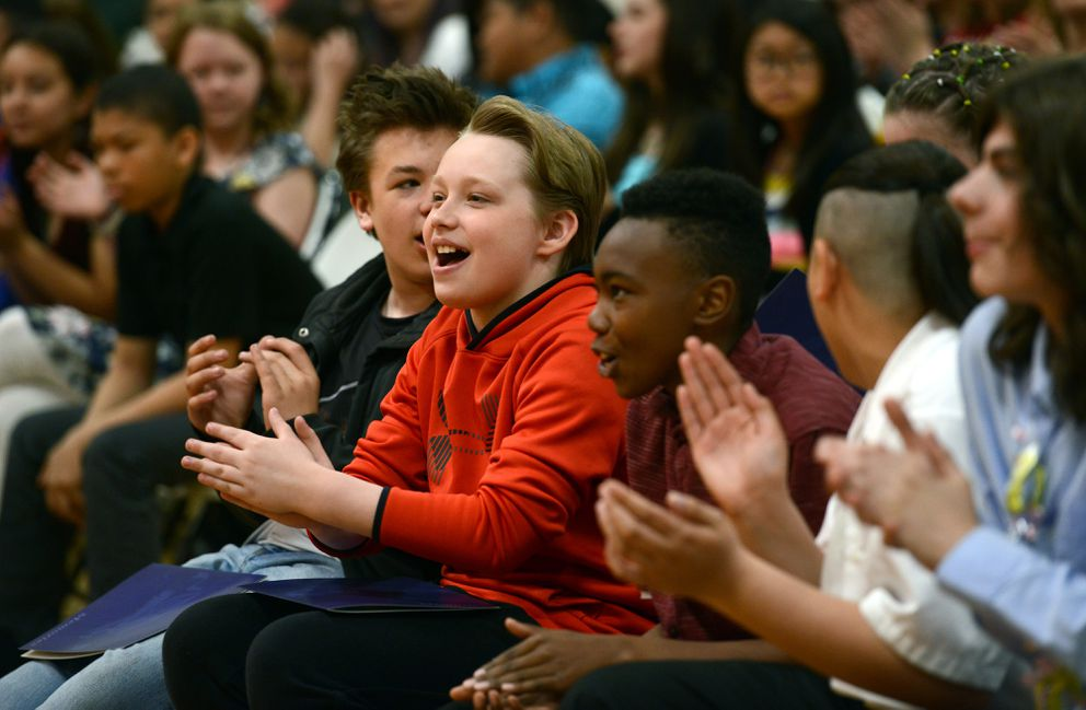 Kohl Russell and classmates applaud during the 6th Grade Moving-Up Ceremony on Tuesday morning May 22, 2019, at Gladys Wood Elementary School. (Erik Hill)