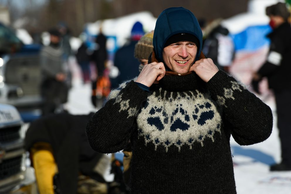 Four-time Iditarod winner Dallas Seavey suits up for the 2021 race start at Deshka Landing in March. (Marc Lester / ADN)