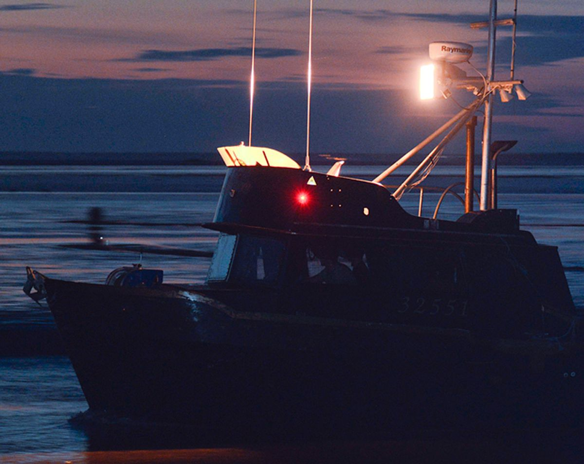 A Cook Inlet drift gillnet salmon boat. Fishermen who saw their fishery value shrink by about two-thirds in 2018 are seeking support for a federal disaster declaration that would enable Congress to appropriate relief funds. (Rashah McChesney / AJOC file)