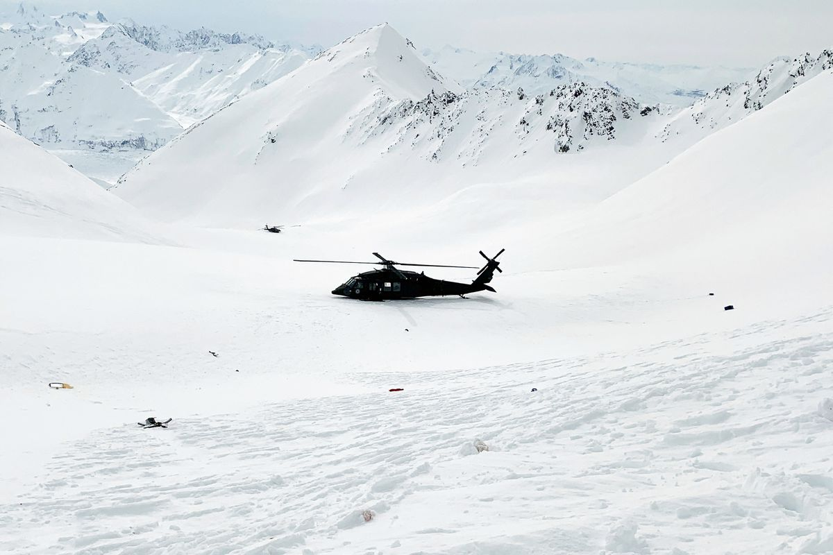 This photo provided by the Alaska Mountain Rescue Group shows an Alaska Army National Guard helicopter at the scene of a helicopter crash near Knik Glacier in Alaska on Sunday, March 28, 2021. (Lance Flint/Alaska Mountain Rescue Group via AP)