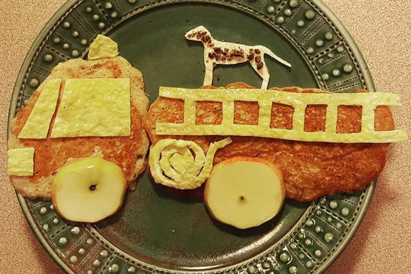 Firetruck pancakes with egg ladder and windows, apple wheels and grated chocolate dog spots. (Photo by Megan Corazza)