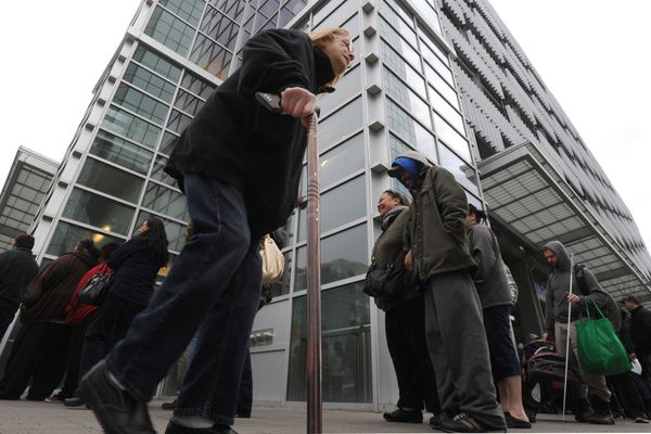 OPINION: Alaska needs to break the old mold, take a new way forward to a sustainable state budget and guaranteed dividend. Senate Bill 114 is the way. Pictured: Alaska residents wait in line to file for their Permanent Fund dividends on the last day for applications, March 31, in 2015.