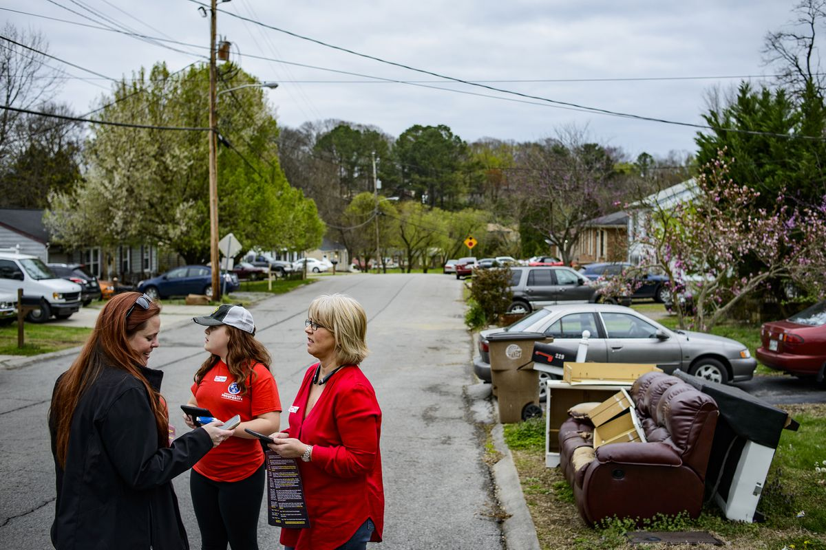 Tori Venable, left, the state director with Americans for Prosperity, along side her daughter, Audrey Venable, center, and Melissa Smithson while going door to door to tell residents to vote against the proposed transit plan for Nashville, Tenn., March 24, 2018. In communities across the country, the billionaire conservative Koch brothers are waging a sophisticated fight against new rail projects and bus routes. (William DeShazer/The New York Times)
