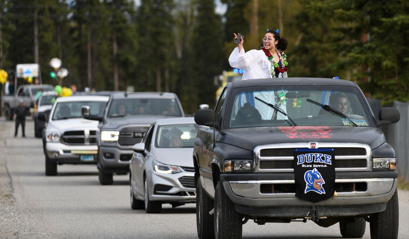 Hailey Williams rides in a car parade for graduates of Delta High School on May 14, 2020. (Marc Lester / ADN)