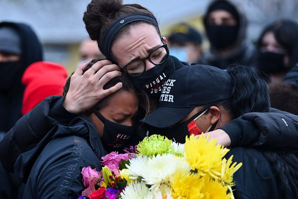 Tay Elhindi, left, Emma Luten and Athena Papagiannopoulos embrace Monday, April 12, 2021, during a vigil for Daunte Wright in Brooklyn Center, Minn. A police officer fatally shot Wright on Sunday. Washington Post photo by Joshua Lott