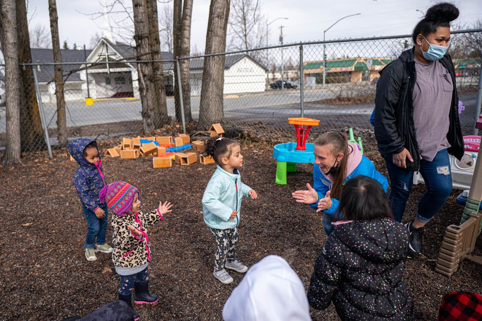 Floor supervisor Sarah Carlson, in blue, engages kids at Carousel Child Care Center on Friday, April 30, 2021 in Anchorage. The Anchorage Assembly has lifted many COVID-19 restrictions, but many businesses plan on keeping some safety standards in place. (Loren Holmes / ADN)