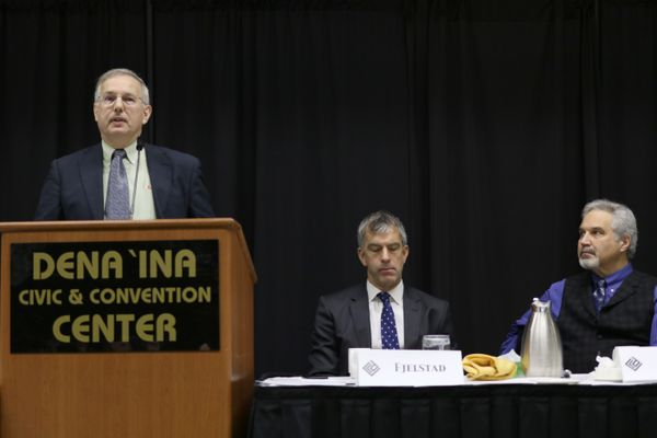 Alaska House Speaker Bryce Edgmon, D-Dillingham, speaks Thursday, January 4, 2018, to members of the Resource Development Council in Anchorage. In in the middle is Eric Fjelstad, an attorney at Perkins Coie LLP and an RDC board member and right, Senate President Pete Kelly, R-Fairbanks. (Nathaniel Herz / ADN)