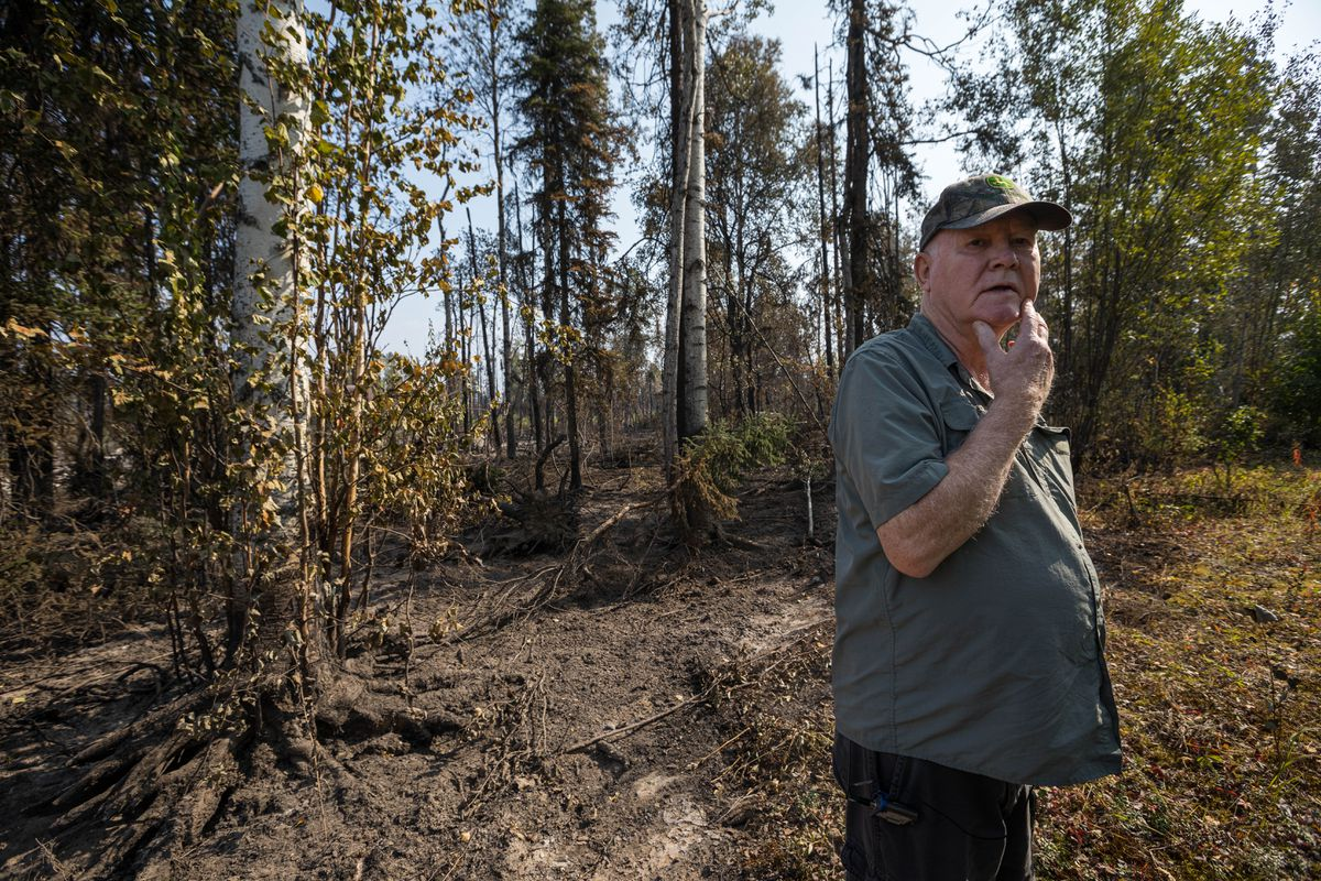 Pete Petram stands at his property line Friday, Aug. 23, 2019 in Willow. Petram's home was spared by the McKinley fire, which destroyed his next-door neighbor's home and burned around the 20-acre parcel. (Loren Holmes / ADN)
