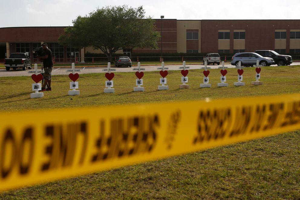 Crosses bearing the names of the victims killed in a shooting at Santa Fe High School are seen in Santa Fe, Texas, U.S., May 21, 2018. REUTERS/Jonathan Bachman