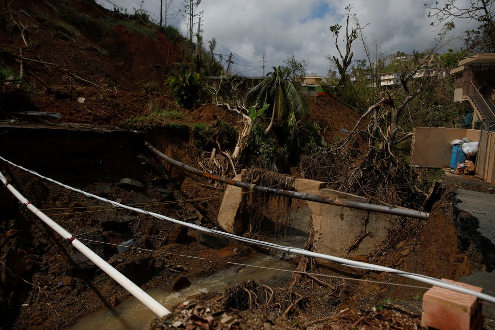 This road outside Barranquitas, Puerto Rico, waswashed away by Hurricane Maria. (REUTERS/Shannon Stapleton)