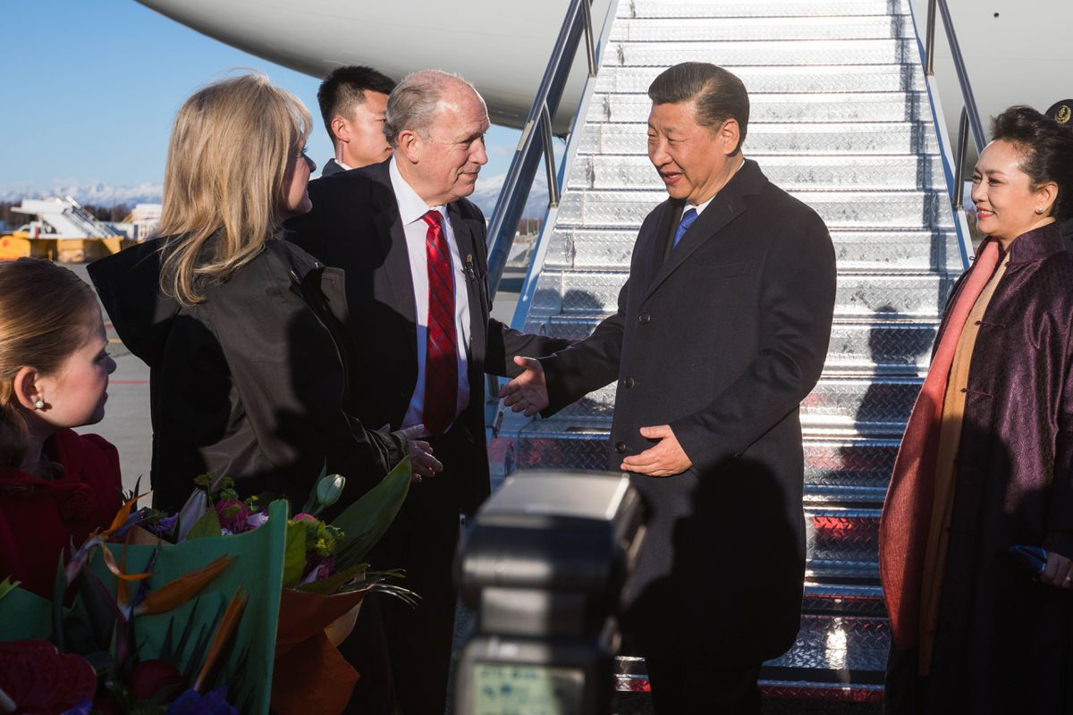 Gov. Bill Walker greets Chinese President Xi Jinping and his wife Peng Liyuan after they landed in Anchorage on Friday. (Loren Holmes / Alaska Dispatch News)