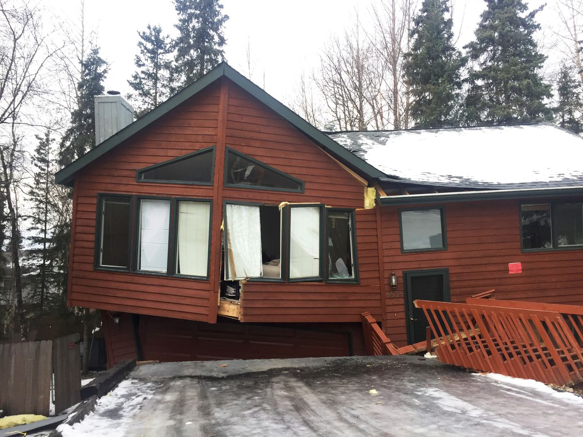 This home on Dome Circle in Eagle River partially collapsed in Friday's earthquake. Logan Cushman was inside when the home collapsed, but was able to escape unharmed. Photographed Sunday, Dec. 2, 2018. (Matt Tunseth / ADN)