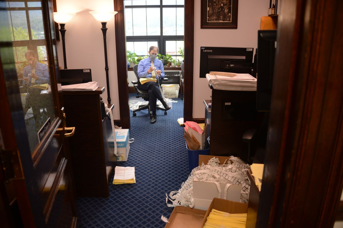 Sen. Jesse Kiehl, D-Juneau, is seen in his office Monday, July 13, 2020. Kiehl is hand-stuffing newsletters with absentee ballot applications for all 22,000 households in his district. (James Brooks / ADN)
