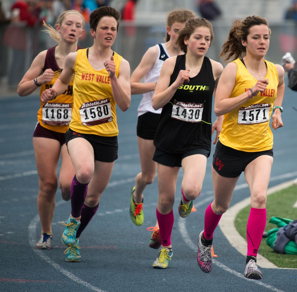 West Valley's Kendall Kramer  leads South's Ava Earl  and teammate Faith Widman going into the final lap of the girls 1,600. Kramer won in 5:16.39. (Photo by Stephen Nowers)