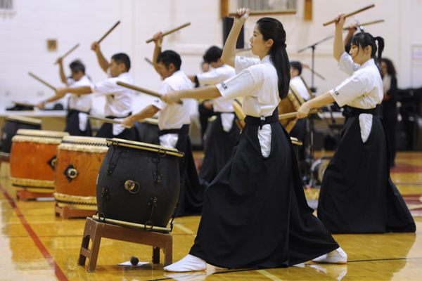 Petty Officer 3rd class Marimo Kubo, center, of Japan Maritime Self-Defense Force Training Squadron's Taiko drummers Shozuidaiko performed at Central Middle School of Science on Thursday, Sept. 28, 2017. The Training Squadron's band and Taiko drummers visit and performance at an ASD school is a