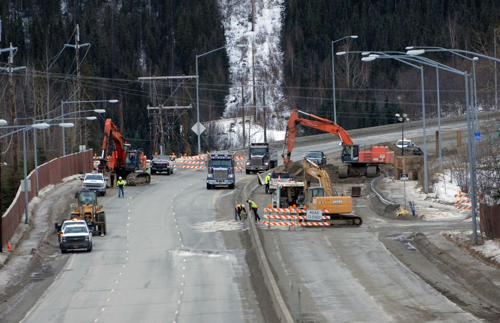 Workers repair the Briggs Bridge in Eagle River on Sunday, Dec. 2, 2018. The bridge was damaged when a magnitude 7.0 earthquake struck the area on Friday, Nov. 30. (Star photo by Matt Tunseth)