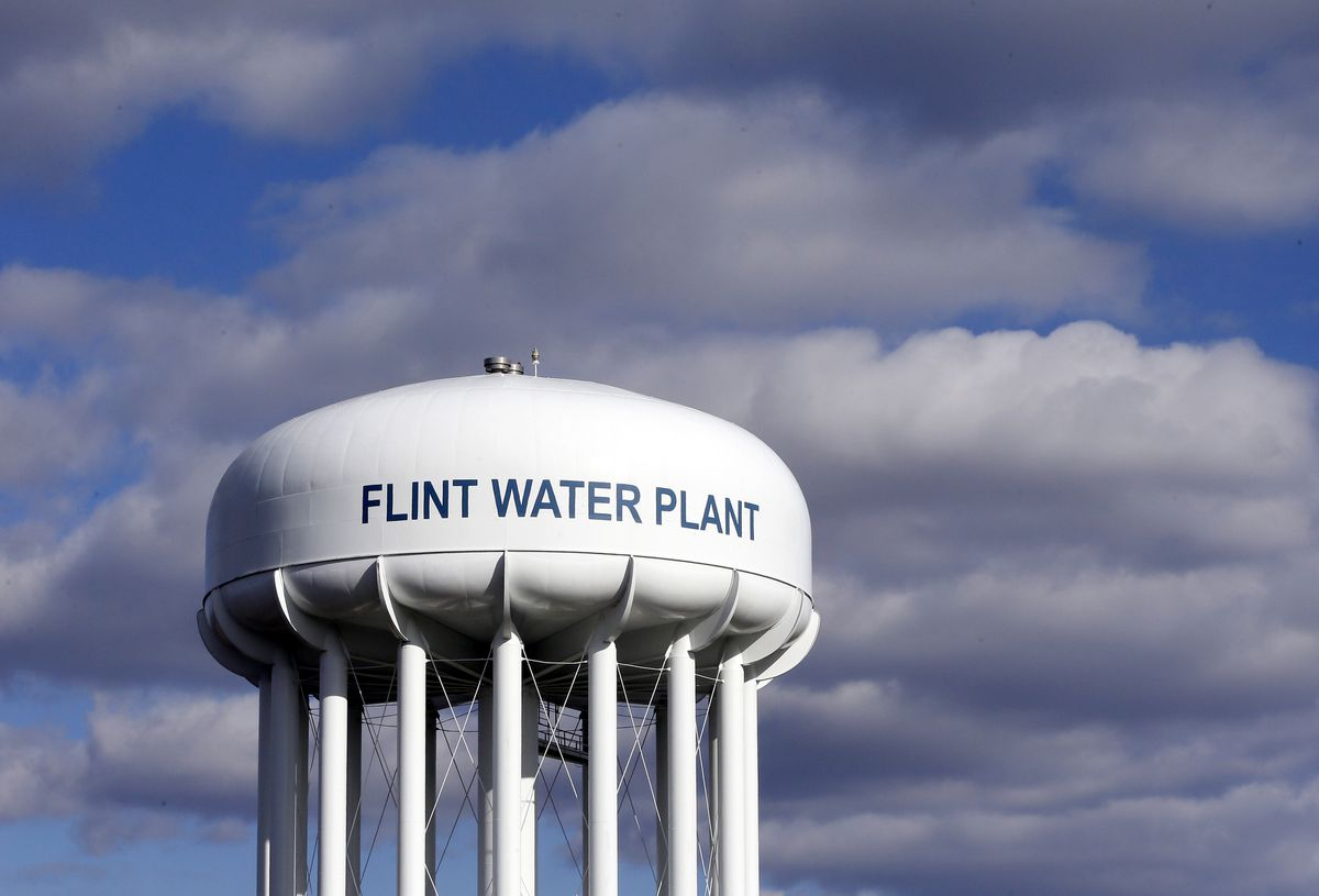 FILE - In this March 21, 2016, file photo, the Flint Water Plant water tower is seen in Flint, Mich. (AP Photo/Carlos Osorio, File)